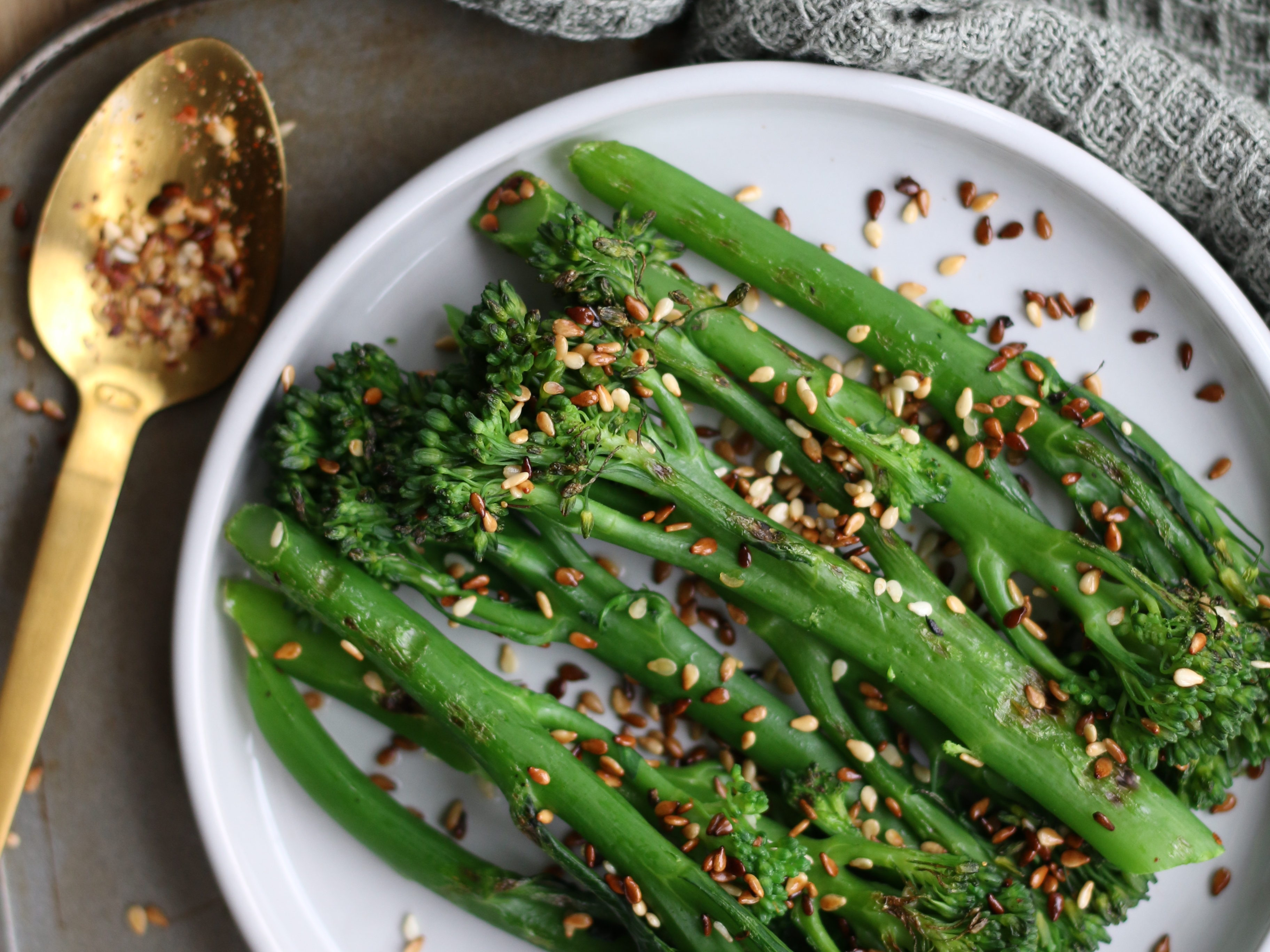 charred tenderstem with ginger and tamari dressing