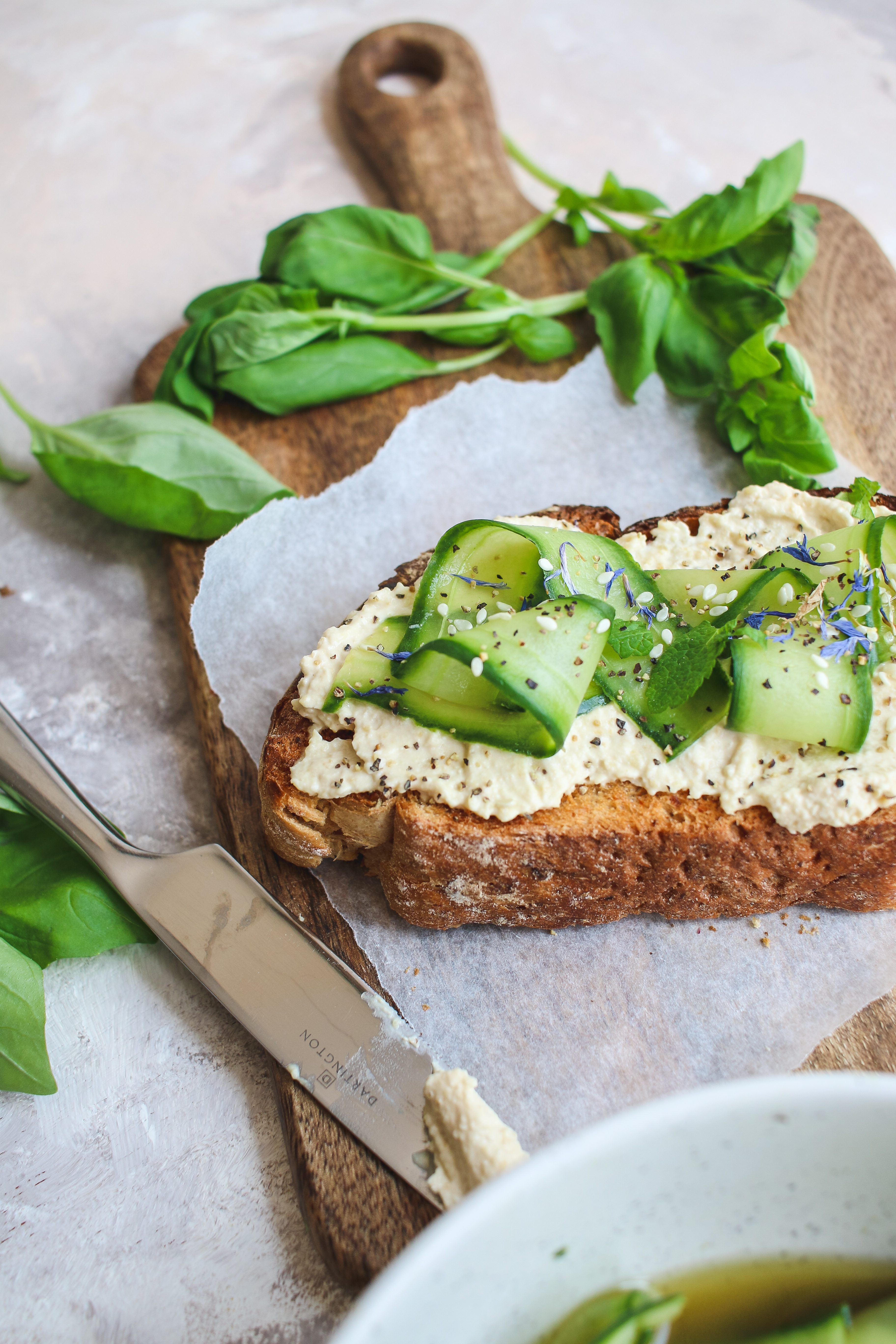 pickled cucumber and hummus toast